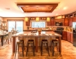 home run kitchen with coffered ceiling and appliances natalia tx